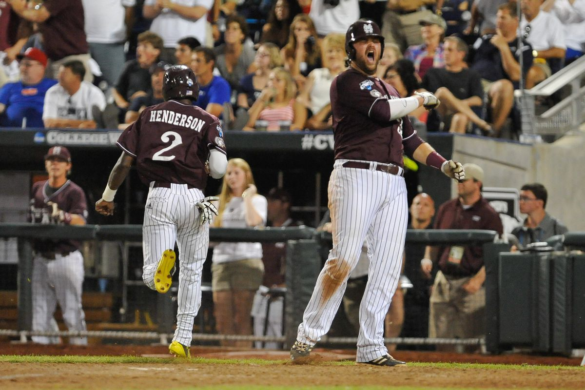 Wes Rea celebrates in the eighth inning Monday night as Trey Porter brings he and Demarcus Henderson home to give State the lead for good.