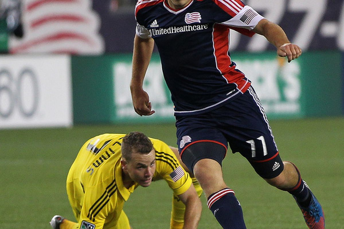 FOXBORO, MA - JUNE 16:  Kelyn Rowe #11 of the New England Revolution gets by Josh Williams #3 of the Columbus Crew in the second half during a game at Gillette Stadium on June 16, 2012 in Foxboro, Massachusetts. (Photo by Jim Rogash/Getty Images)