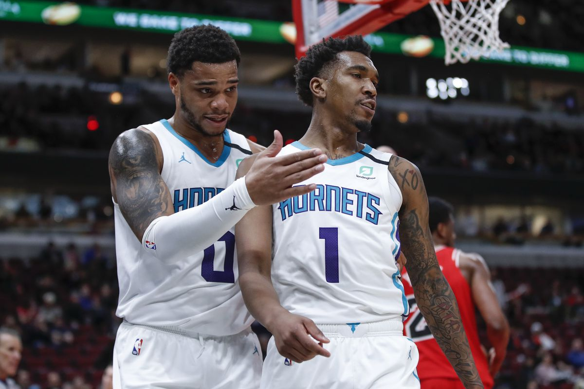 Charlotte Hornets guard Malik Monk celebrates with forward Miles Bridges against the Chicago Bulls during the second half at United Center.