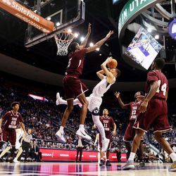 BYU guard Rylan Bergersen (1) tries to get off a shot with Texas Southern center Trayvon Reed (5) defending the basket as BYU and Texas Southern play an NCAA basketball game in Provo at the Marriott Center on Saturday, Dec. 23, 2017. BYU won 73-52.