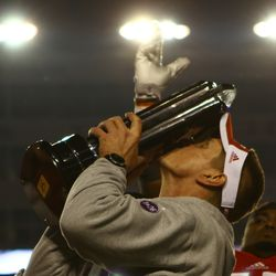 Head Coach Gary Andersen kisses the Big 10 West championship trophy