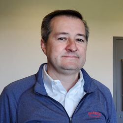 Tom Ricketts in happier times, at Sloan Park in Mesa February 17