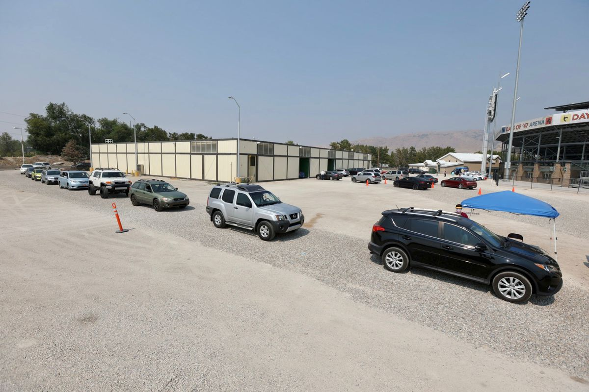People line up in their cars for a COVID-19 test at the Utah State Fairpark in Salt Lake City on Monday, Aug. 16, 2021.