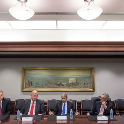 Libertarian presidential candidate Gary Johnson, center, and his running mate, Bill Weld, second from left, speak with the Deseret News and KSL editorial board in Salt Lake City on Friday, Aug. 19, 2016.