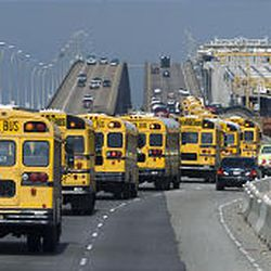 Galveston Independent School District buses carrying evacuees head north on I-45 in Galveston, Texas.