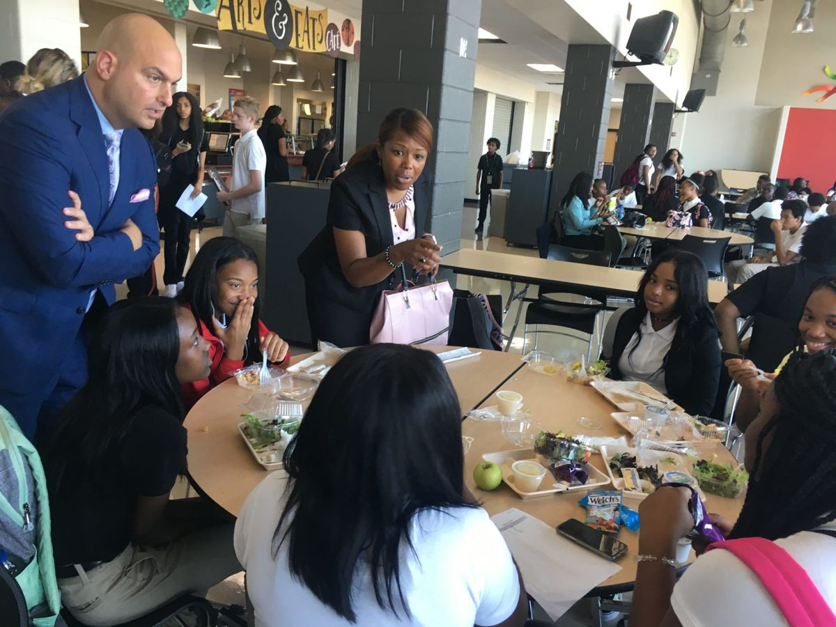 Superintendent Vitti and Angelique Peterson-Mayberry, vice-president of the school board, speaking to several students who said they came to the Detroit School of Arts from outside the city's main district.