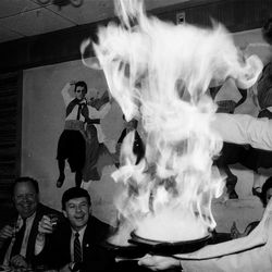 The flaming cheese dish is said to have been created in Chicago's Greektown.  Sun-Times Archives