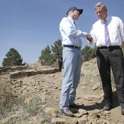 Away from the ceremony and the crowds of well wishers Friday, Sept. 21, 2012, Interior Secretary Ken Salazar, Agriculture Secretary Tom Vilsack thank each other for their efforts in making Chimney Rock a National Monument west of Pagosa Springs, Colo. (AP Photo/The Durango Herald, Shaun Stanley)