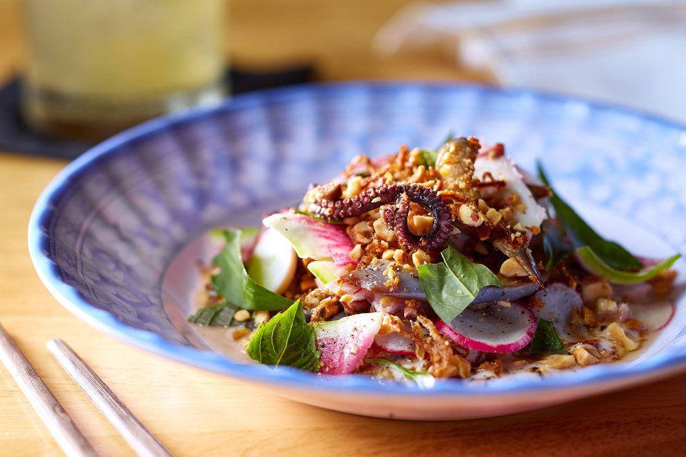A salad of octopus, eggplant, shaved radish, and roasted peanuts.