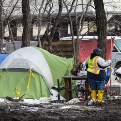 Workers from the city's Department of Streets and Sanitation clear out a homeless encampment near South Desplaines Street and West Roosevelt Road, Monday morning, Feb. 10, 2020.