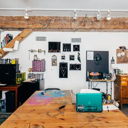 My studio is in the <b>Morgan Fine Arts</b> building in Greenpoint. I've been here about a year and some odd months, and I love it. It's an amazing building and a great environment—it used to be an old pillow factory. The entire brand is created in here,