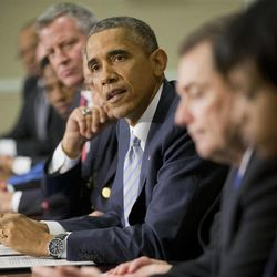 President Barack Obama, center, speaks during his meeting with elected officials, law enforcement officials and community and faith leaders in the Old Executive Office Building on the White House Complex in Washington, Monday, Dec. 1, 2014. Obama said that in the wake of the shooting of an unarmed 18-year-old man in Ferguson, Missouri, he wants to make sure to build better trust between police and the communities they serve.