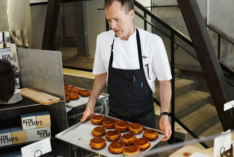 Lincoln Carson takes warm kouign amann to the display at Bon Temps restaurant in Los Angeles
