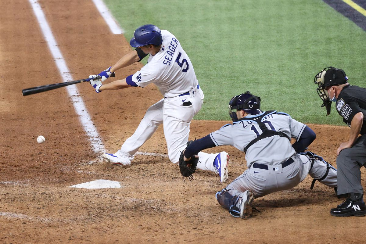 Corey Seager #5 of the Los Angeles Dodgers hits an RBI fielders choice to bring home Mookie Betts (not pictured) against the Tampa Bay Rays during the sixth inning in Game Six of the 2020 MLB World Series at Globe Life Field on October 27, 2020 in Arlington, Texas.