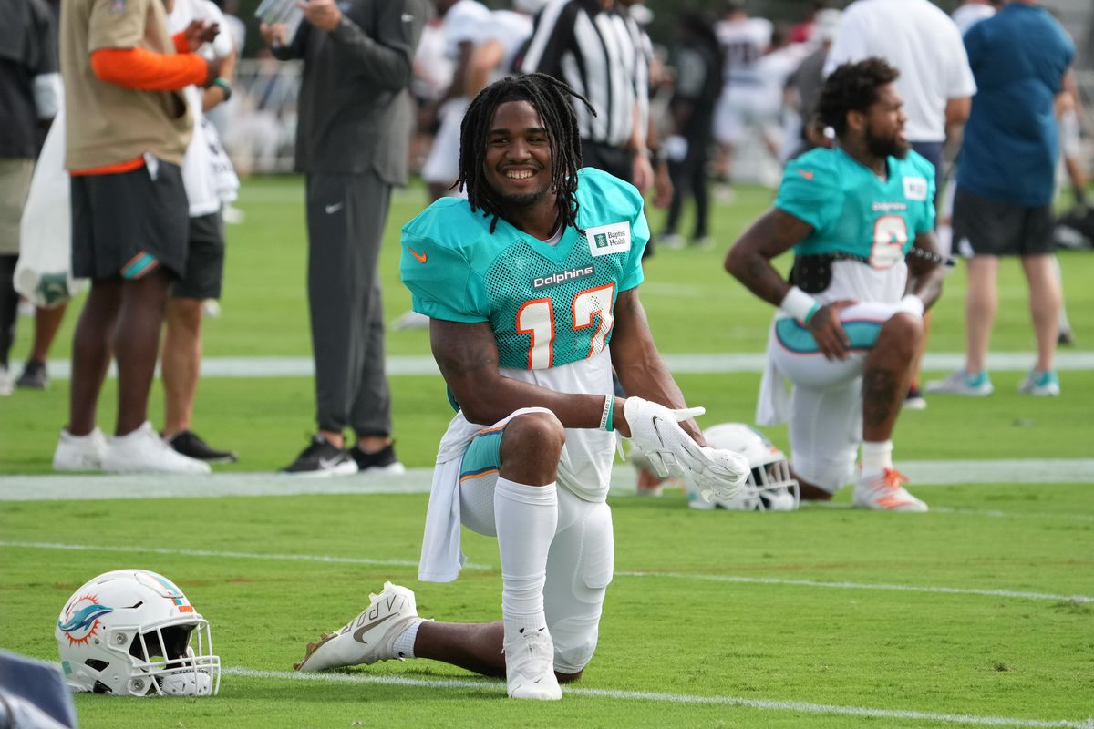 Miami Dolphins wide receiver Jaylen Waddle (17) stretches during training camp at Baptist Health Training Complex.