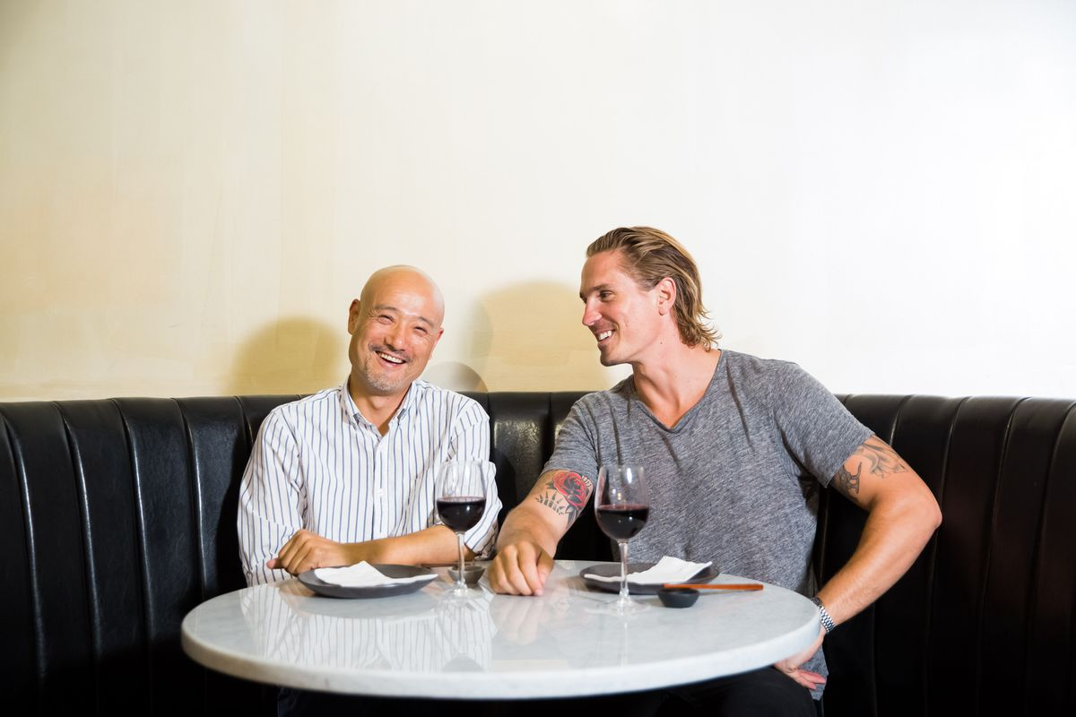 Jeff Lam and Eddy Buckingham sit in a banquette