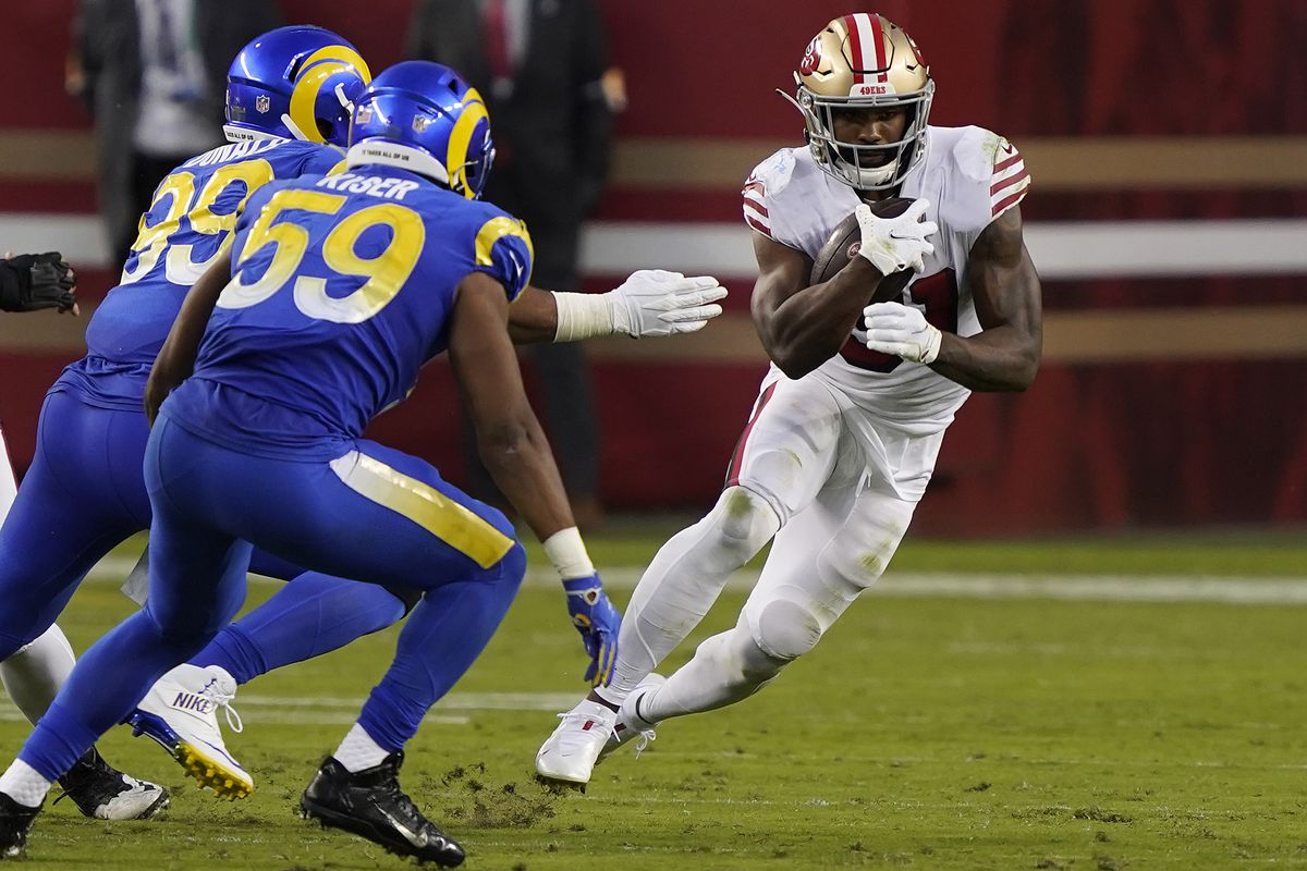 Raheem Mostert #31 of the San Francisco 49ers runs against the Los Angeles Rams during the second quarter at Levi's Stadium on October 18, 2020 in Santa Clara, California.