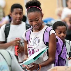 Arlana Spann, 11, picks out a binder as free school supplies are distributed during Operation Homefront's annual Back-to-School Brigade event at Hill Field Elementary in Clearfield on Tuesday, Aug. 13, 2019.