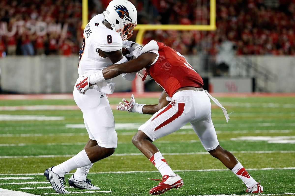 True freshman Kerry Thomas attempts to evade a tackler on his only career completion