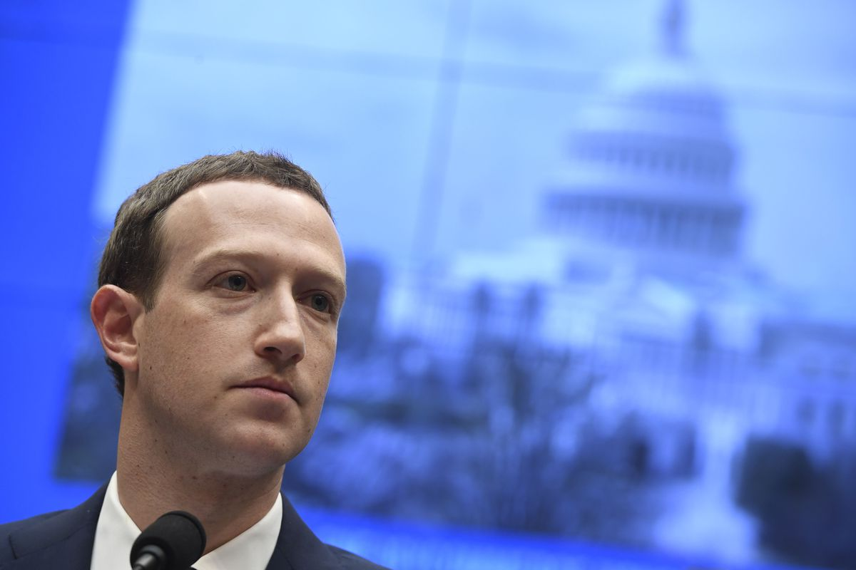 Mark Zuckerberg in front of a microphone at a US House of Representatives hearing in 2018.