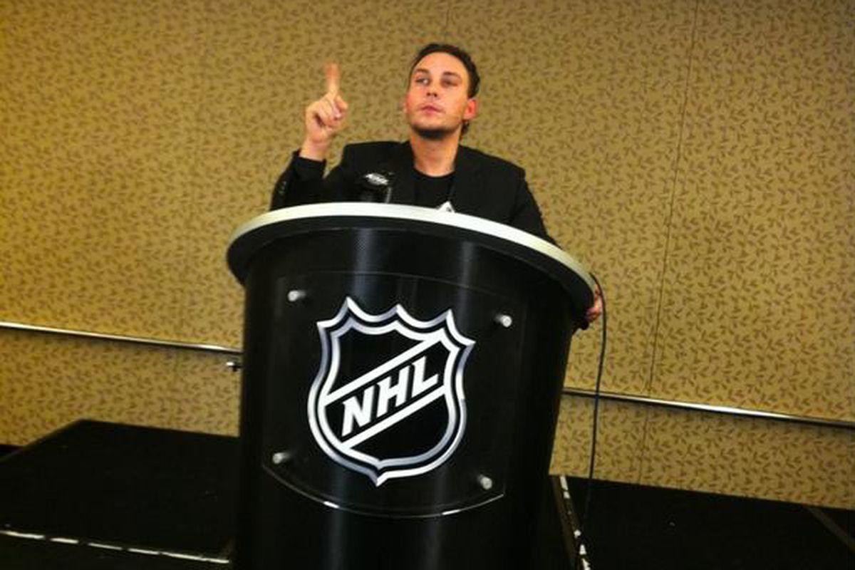 Constantine Gamvrelis, aka @jetsxoxo poses at the NHL podium