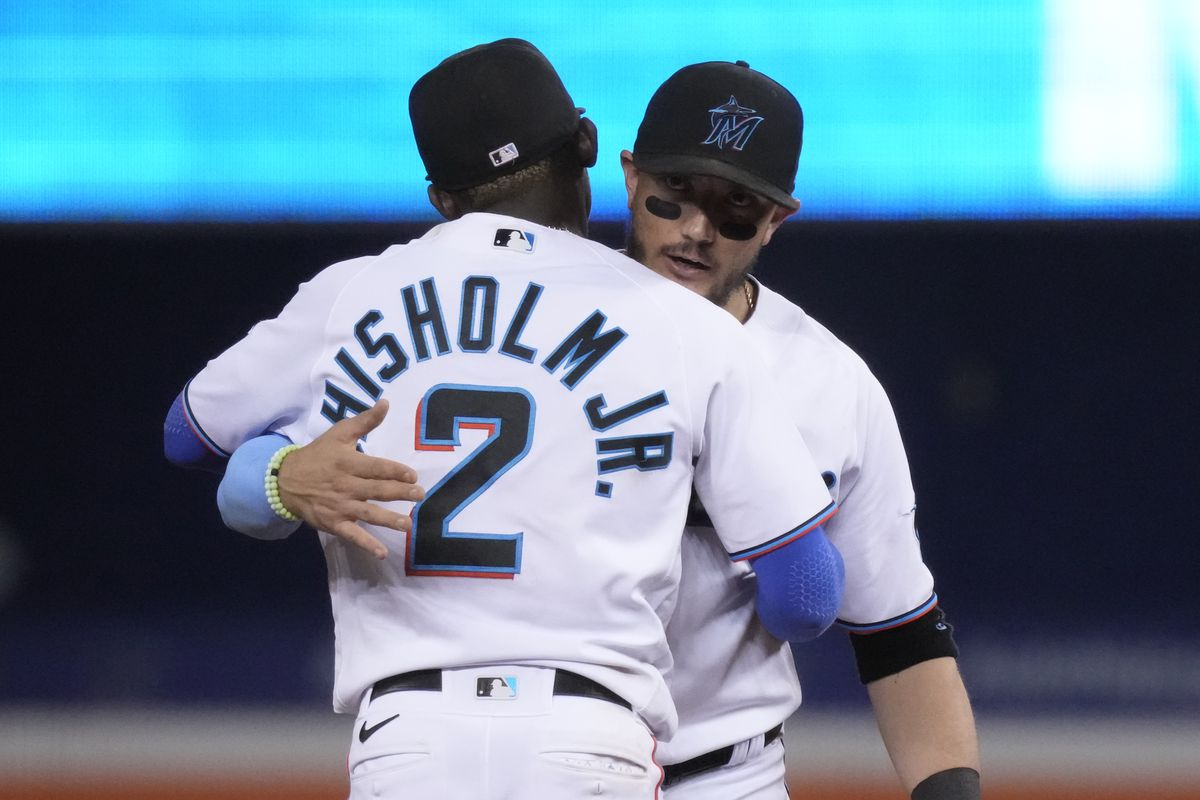 Jazz Chisholm Jr. #2 and Miguel Rojas #19 of the Miami Marlins celebrate after defeating the New York Mets by score of 6-3 at loanDepot park