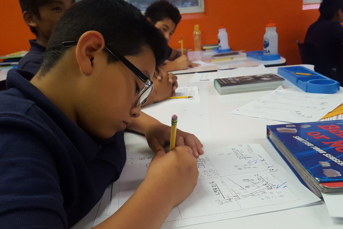Sixth grade students work on math problems during a September 2018 class at Vega Collegiate Academy in Aurora.