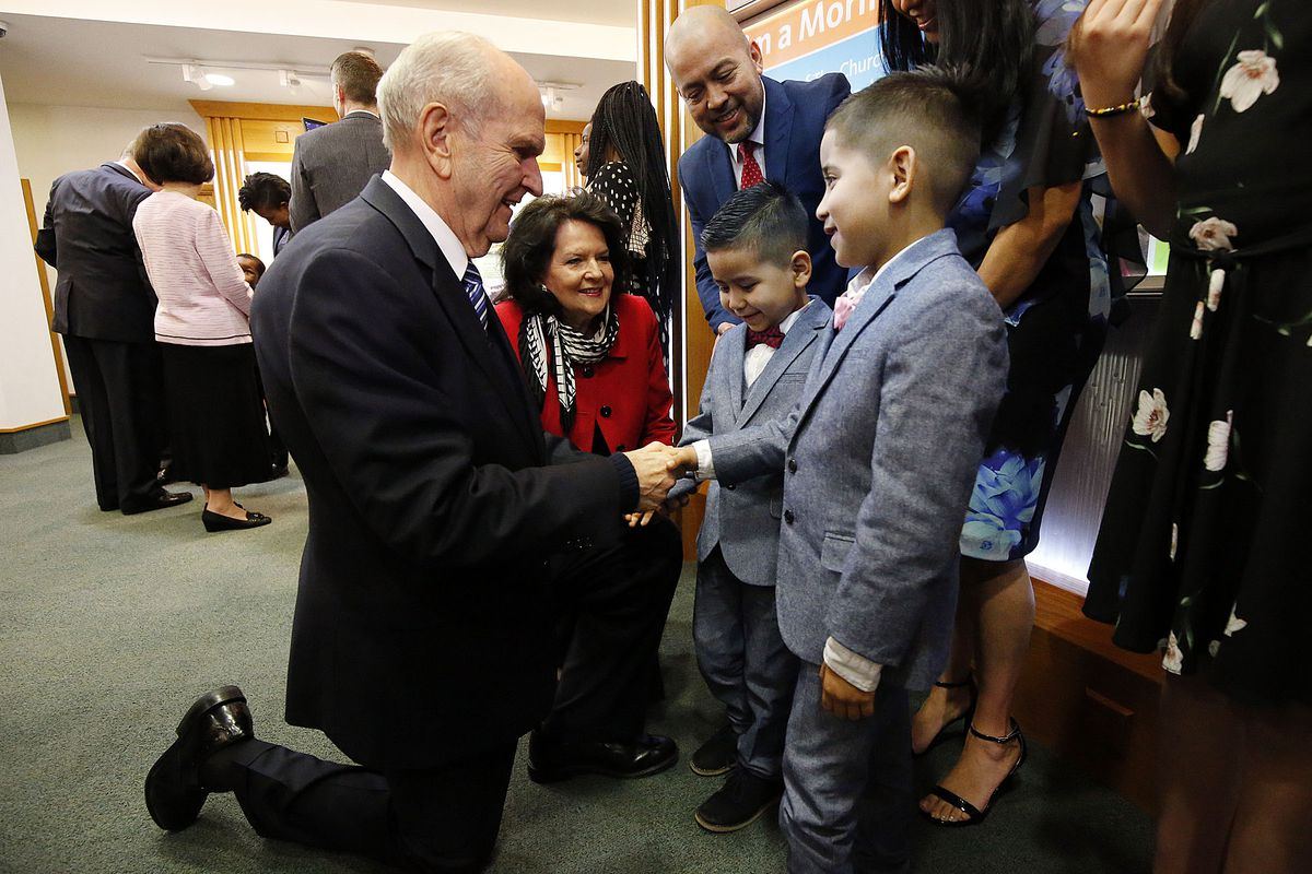 President Russell M. Nelson and Sister Wendy Nelson of The Church of Jesus Christ of Latter-day Saints greet the Vargas family at the Hyde Park Visitors Center in London on Thursday, April 12, 2018. The boys are Juan David Vargas Saavedra, right, and Joseph Daniel Vargas Saavedra.