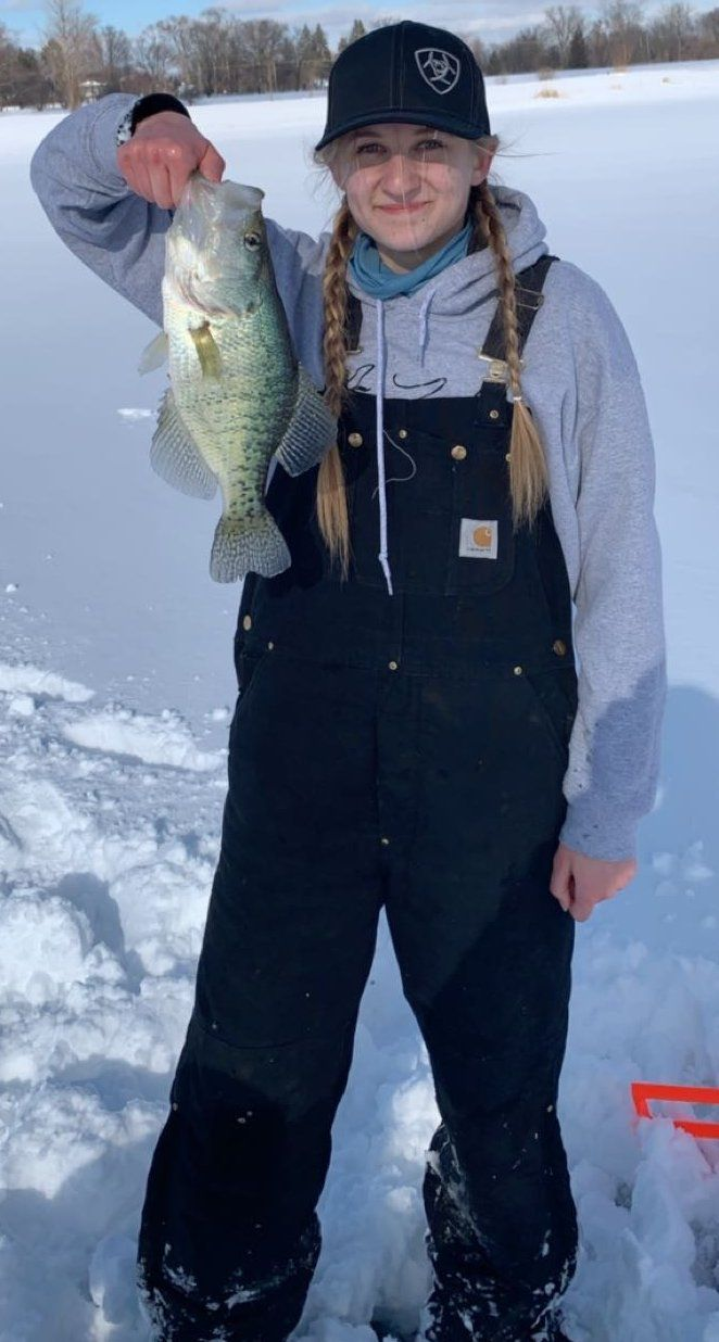Full view of Abby Turek with a big crappie caught on a snow day Monday. Provided photo