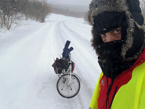 Tim Moore is the cyclist who went out in the cold. Wearing a snood.