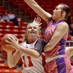 Utah's Taryn Wicijowski, left, is blocked by TCU's Rachel Rentschler as the University of Utah loses 105-96 to Texas Christian University in quadruple overtime at the Huntsman Center in Salt Lake City on Wednesday.