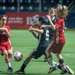 Before home games, a youth soccer game is played on the field