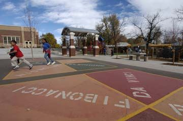 Colorful, inviting play areas, such as this Learning Landscapes-designed playground at Denver's Edison Elementary School, encourage physical activity.