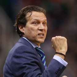 Jazz coach Quin Snyder gives his approval as the Utah Jazz play the Golden State Warriors in NBA basketball Monday, Nov. 30, 2015, in Salt Lake City.