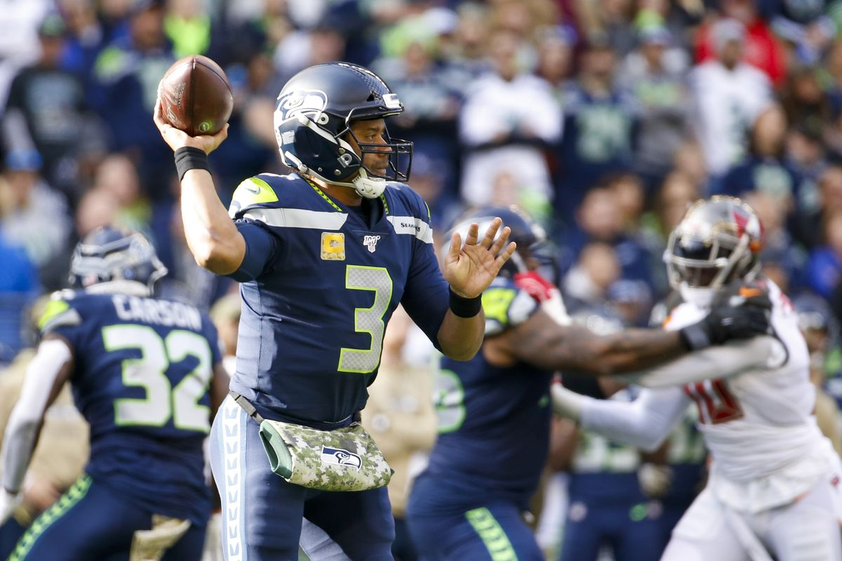 Seattle Seahawks quarterback Russell Wilson passes against the Tampa Bay Buccaneers during the second quarter at CenturyLink Field.