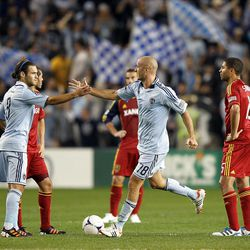 KANSAS CITY, KS - APRIL 14:  Aurelien Collin #78 of Sporting Kansas City is congratulated by Graham Zusi #8 after scoring during the Major League Soccer game against  Real Salt Lake on April 14, 2012 at Livestrong Sporting Park in Kansas City, Kansas.  (Photo by Jamie Squire/Getty Images)
