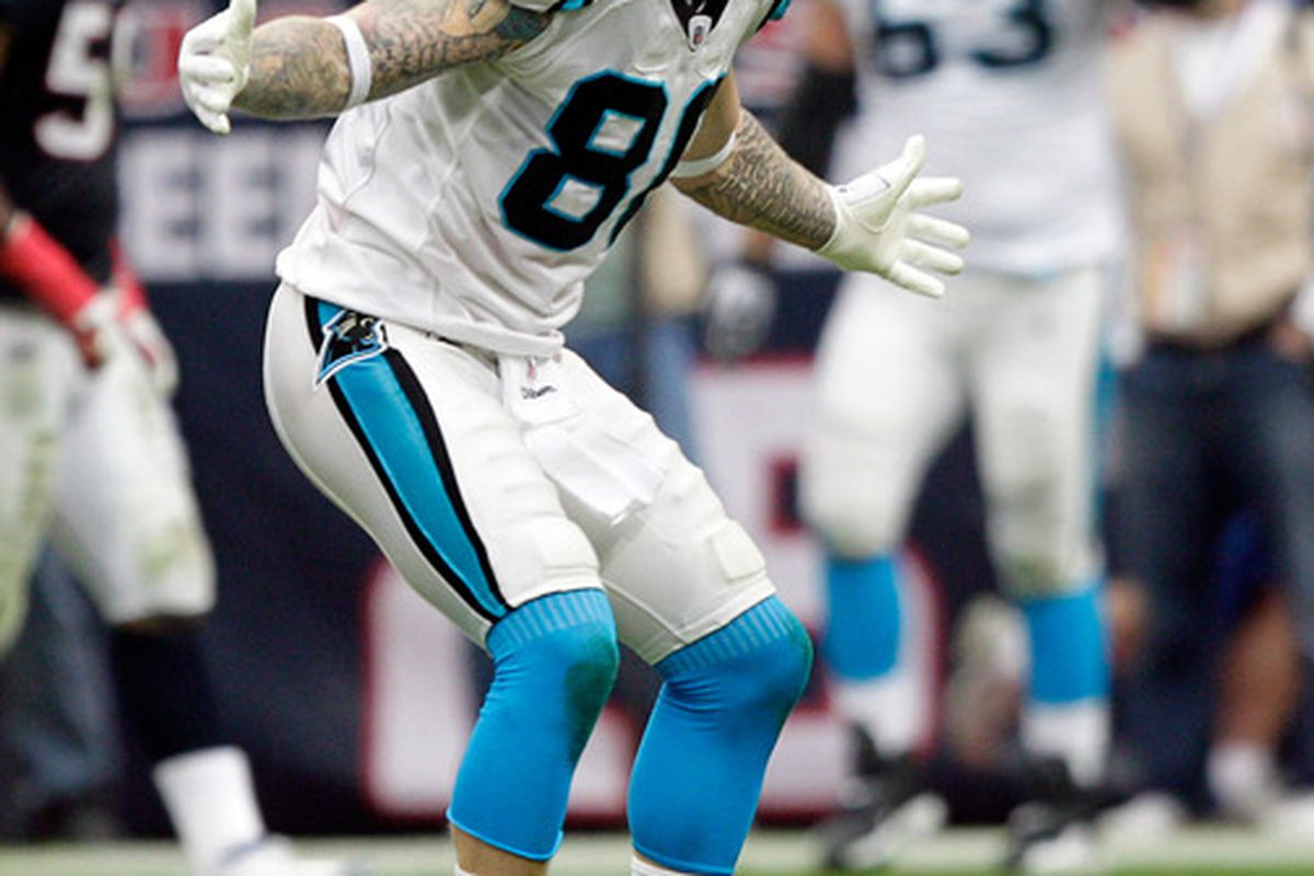 HOUSTON - DECEMBER 18:  Tigh-end Jeremy Shockey #80 of the Carolina Panthers taunts the Houston Texans bench after a Carolina score at Reliant Stadium on December 18, 2011 in Houston, Texas.  (Photo by Bob Levey/Getty Images)