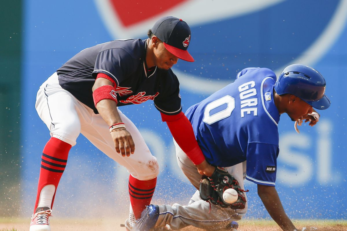 Terrance Gore #0 of the Kansas City Royals steals second base as the ball gets away from Francisco Lindor #12 of the Cleveland Indians during the eighth inning at Progressive Field on September 17, 2017 in Cleveland, Ohio.