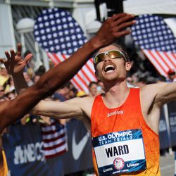 Jared Ward crosses the finish line and is greeted by Meb Keflezighi during the U.S. Olympic Marathon Trials in Los Angeles Ca.,  Saturday, February 13, 2016.   Ward took third overall, earning a spot on the U.S. Olympic team.