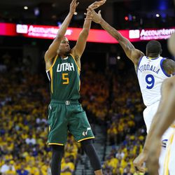 Utah Jazz guard Rodney Hood (5)shoots over Golden State Warriors forward Andre Iguodala (9) in the second half of Game 1 of the NBA Western Conference semifinals at the Oracle Arena in Oakland on Tuesday, May 2, 2017.