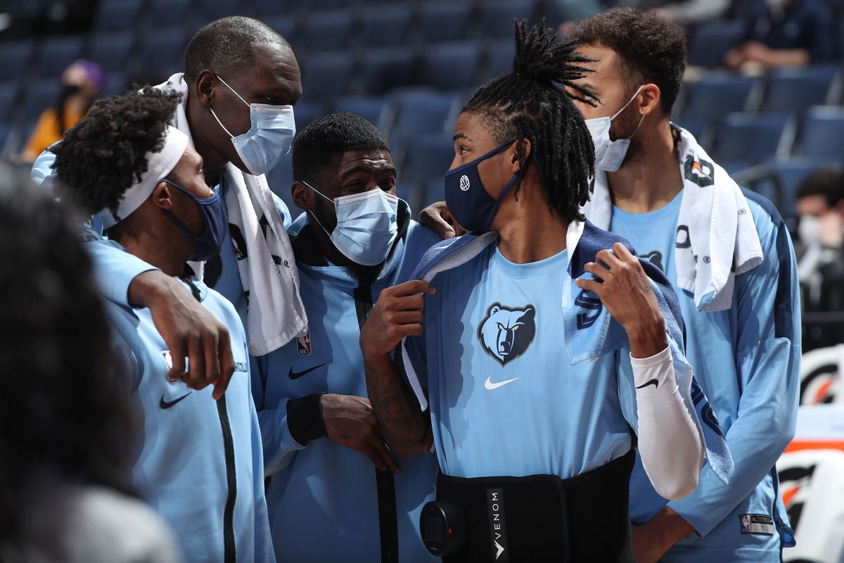Ja Morant #12 of the Memphis Grizzlies talks to teammates during a preseason game against the Atlanta Hawks on December 19, 2020 at FedExForum in Memphis, Tennessee.