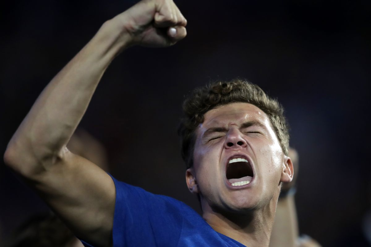 A BYU fan celebrates as BYU and Utah play an NCAA football game at LaVell Edwards Stadium in Provo on Saturday, Sept. 11, 2021.
