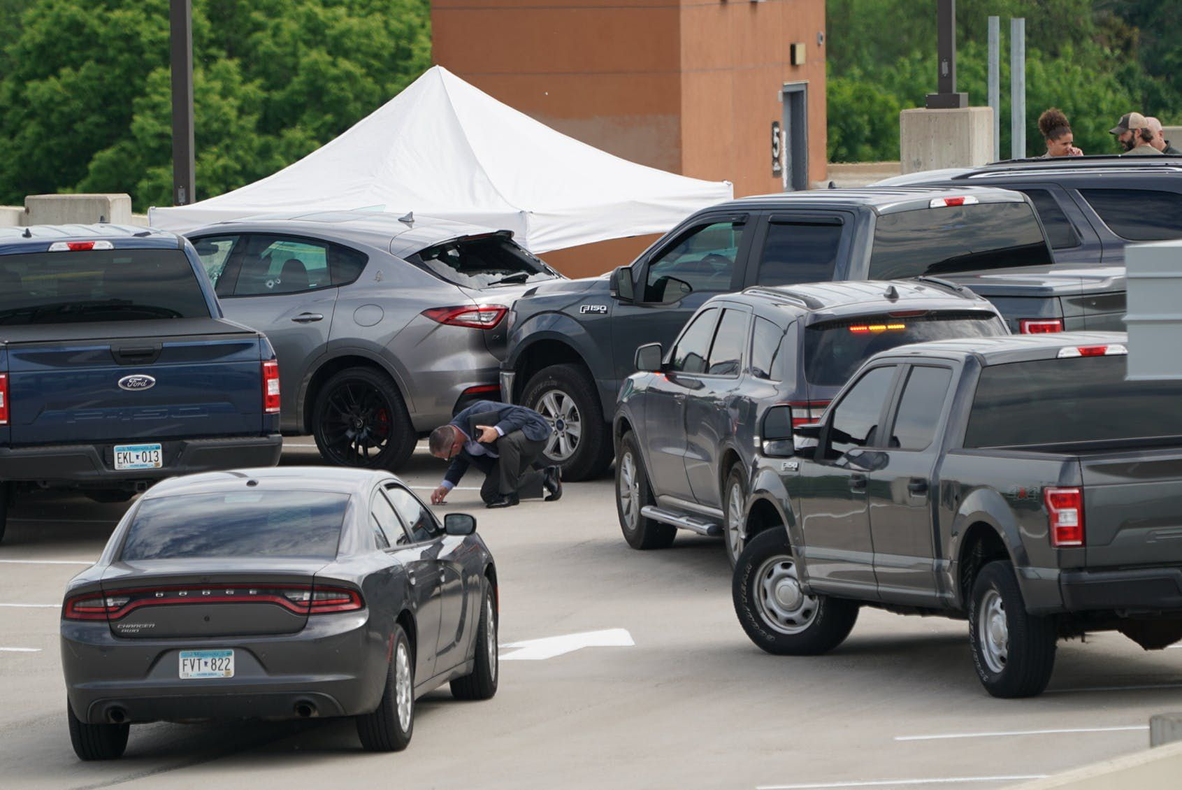 The shooting by Hennepin County sheriff's deputies occurred as authorities pursued a murder suspect, sources said. Minneapolis police were not involved.