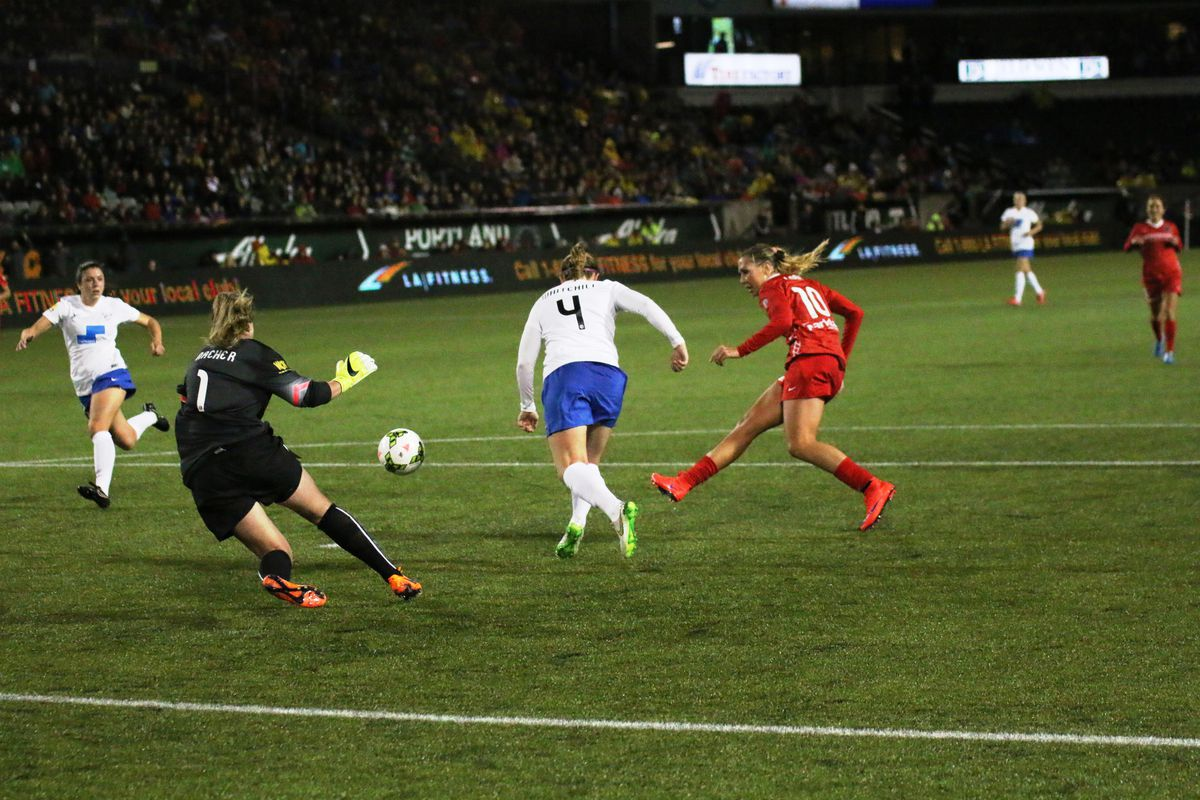 Midfielder Allie Long slots home her second goal of the night as Portland Thorns FC beat the Boston Breakers 4-1 in their 2015 NWSL season opener at Providence Park Saturday, April 11, 2015