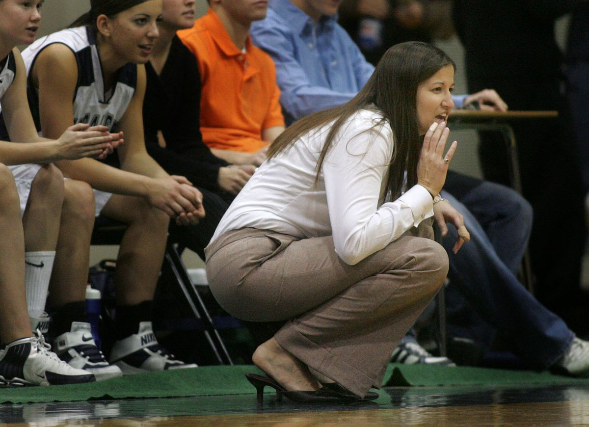 Elizabeth Darger, head coach for the girls basketball team at Timpanogos High calls out instructions to her players on Dec. 16, 2005.