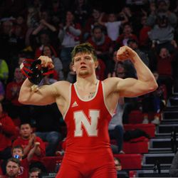 Nebraska's Taylor Venz flexes after defeating Michigan's Jelani Embree in their 184-pound match Friday at the Devaney Sports Center.