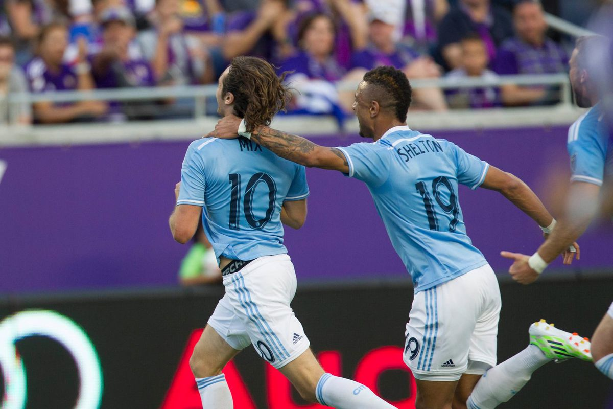 Mix celebrates with Khiry Shelton after scoring New York City's first-ever MLS goal