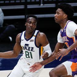 Utah Jazz guard Miye Oni (81) dribbles against Phoenix Suns center Damian Jones (30) during an NBA preseason game at Vivint Smart Home Arena in Salt Lake City on Saturday, Dec. 12, 2020.