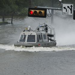The U.S. Coast Guard searches for victims during Tropical Storm Harvey in Houston on Tuesday, Aug. 29, 2017.