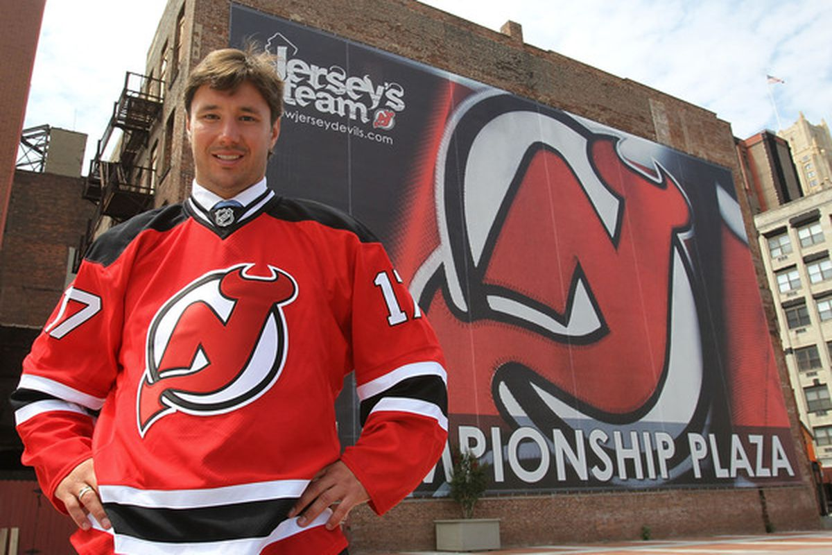 NEWARK NJ - JULY 20:  Ilya Kovalchuk of the New Jersey Devils poses for photographs following the media opportunity announcing his contract renewal at the Prudential Center on July 20 2010 in Newark New Jersey.  (Photo by Bruce Bennett/Getty Images)